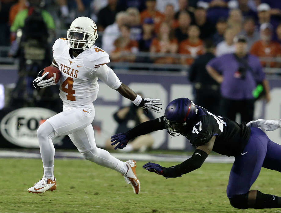 Texas running back Daje Johnson (4) beats TCU linebacker Paul Dawson (47) on the run during the the first half of an NCAA college football game on Saturday, Oct. 26, 2013, in Fort Worth, Texas. (AP Photo/LM Otero) Photo: LM Otero, Associated Press / AP
