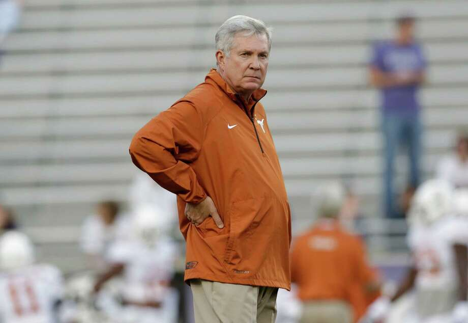 Texas head coach Mack Brown stands on the field before an NCAA college football game against  TCU  Saturday, Oct. 26, 2013, in Fort Worth, Texas. (AP Photo/LM Otero) Photo: LM Otero, Associated Press / AP