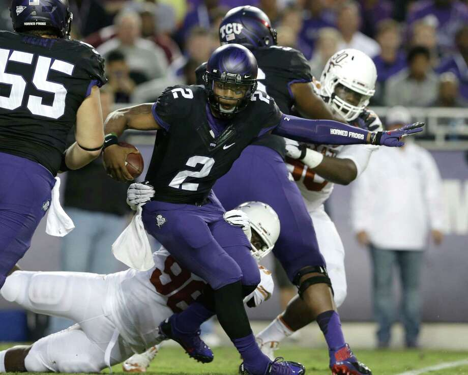 TCU quarterback Trevone Boykin (2) is sacked by TCU defensive tackle Jon Lewis (98) during the first half of an NCAA college football game on Saturday, Oct. 26, 2013, in Fort Worth, Texas. (AP Photo/LM Otero) Photo: LM Otero, Associated Press / AP