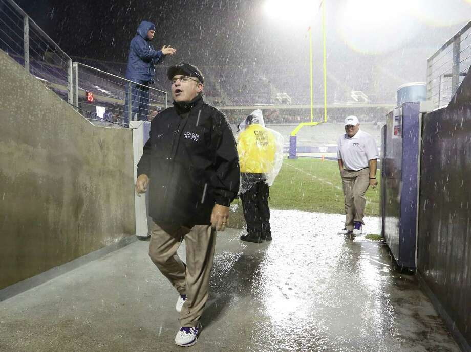 TCU head coach Gary Patterson walks into the visitor's tunnel on his way to meet with Texas coach Mack Brown during a thunder delay during the second quarter of an NCAA college football game on Saturday, Oct. 26, 2013, in Fort Worth, Texas. The teams agreed to play the remainder of the second quarter after half-time with a five-minute break between the second and third quarters.  (AP Photo/LM Otero) Photo: LM Otero, Associated Press / AP