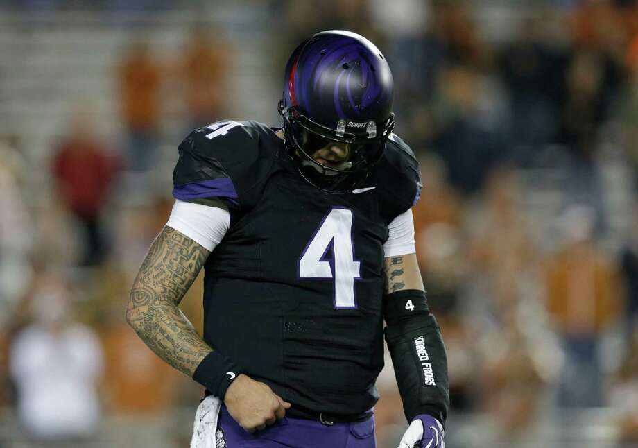 TCU quarterback Casey Pachall (4) hangs his head as he head back to the sideline after throwing a third down incomplete pass during the second half on an NCAA college football game against Texas  Saturday, Oct. 26, 2013, in Fort Worth, Texas. (AP Photo/LM Otero) Photo: LM Otero, Associated Press / AP