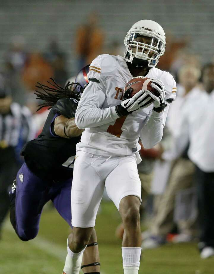 Texas wide receiver Mike Davis (1) catches a pass against TCU cornerback Jason Verrett (2) during the second half on an NCAA college football game Saturday, Oct. 26, 2013, in Fort Worth, Texas. (AP Photo/LM Otero) Photo: LM Otero, Associated Press / AP