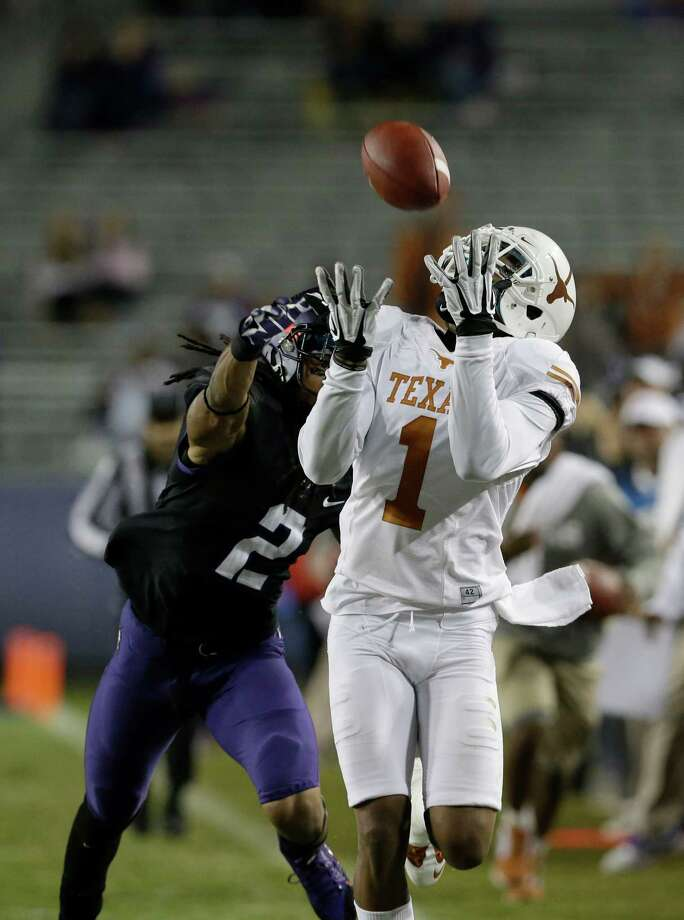 Texas wide receiver Mike Davis (1) catches a pass against TCU cornerback Jason Verrett (2) during the second half on an NCAA college football game Sunday, Oct. 27, 2013, in Fort Worth, Texas. (AP Photo/LM Otero) Photo: LM Otero, Associated Press / AP