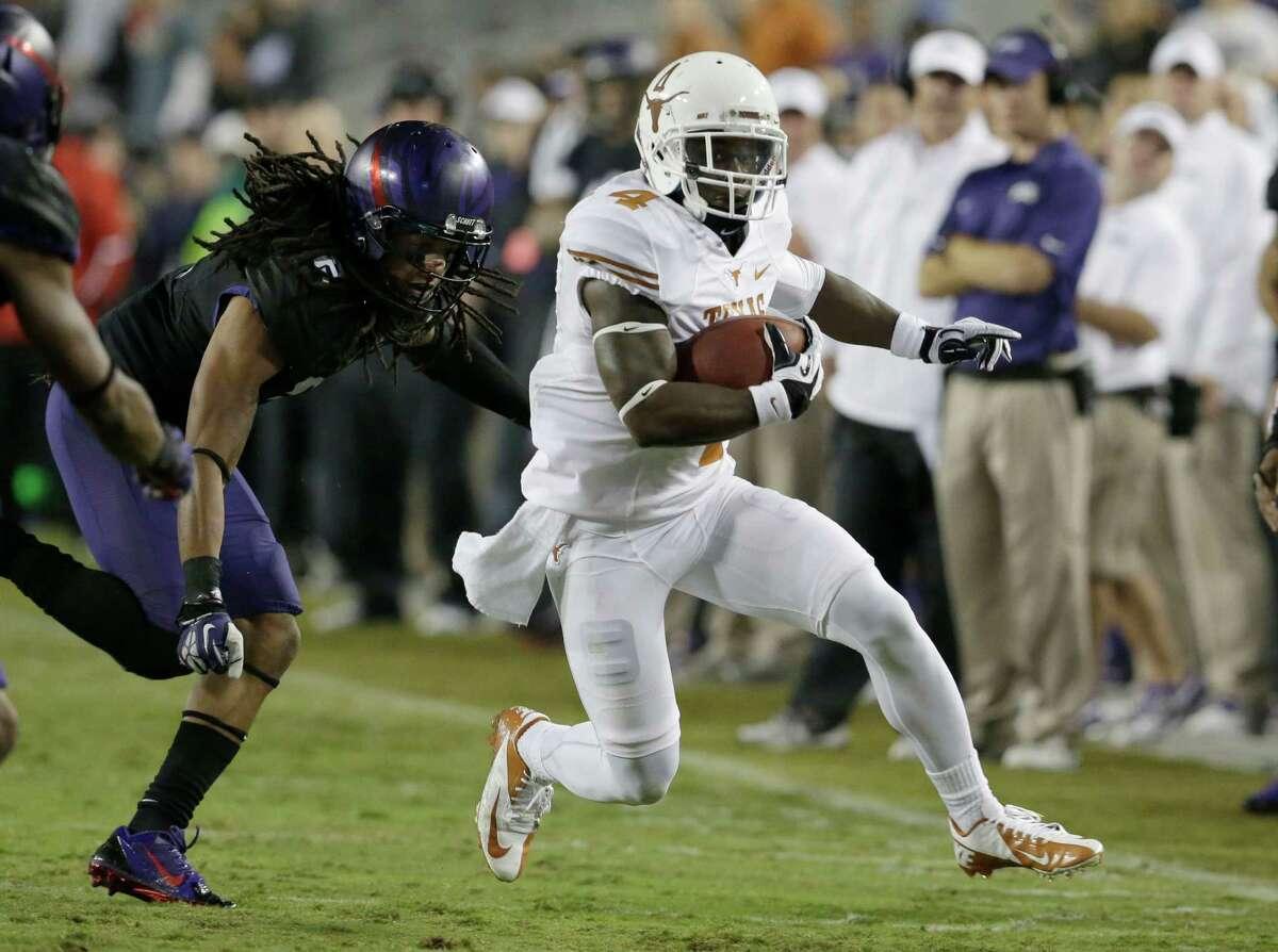 Texas running back Daje Johnson (4) runs agains TCU cornerback Jason Verrett (2)during the second half of an NCAA college football game Saturday, Oct. 26, 2013, in Fort Worth, Texas. (AP Photo/LM Otero)