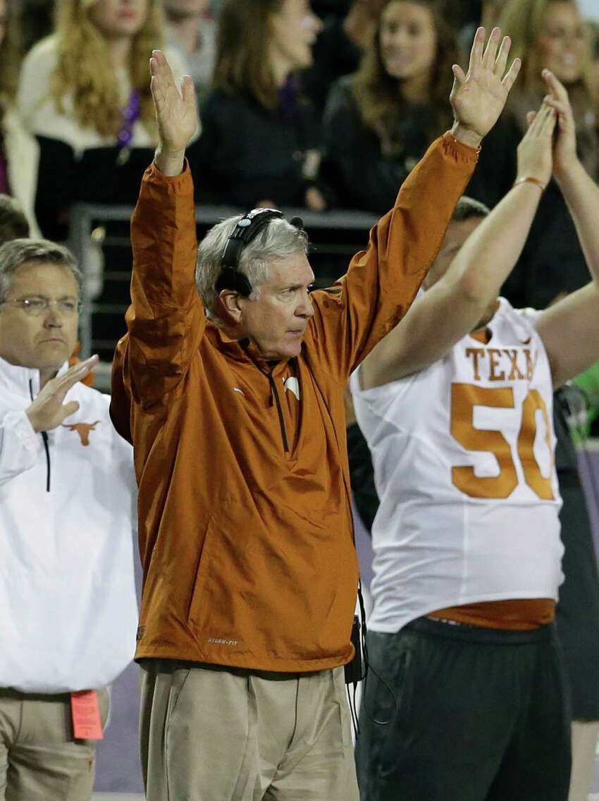Texas head coach Mack Brown celebrates his team scoring a field goal during the second half of an NCAA college football game against TCU Sunday, Oct. 27, 2013, in Fort Worth, Texas. (AP Photo/LM Otero)