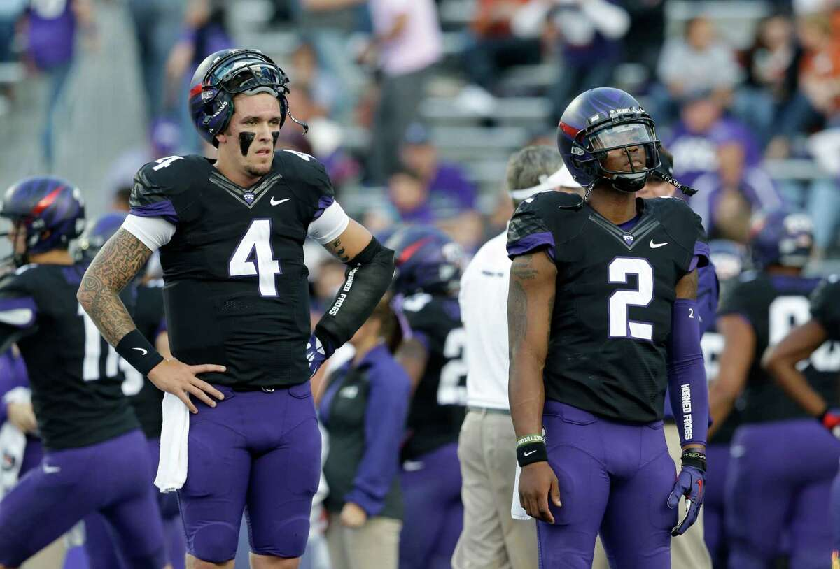 TCU quarterbacks Casey Pachall (4) and Trevone Boykin (2) stand on the field during warm ups before an NCAA college football game against Texas Saturday, Oct. 26, 2013, in Fort Worth, Texas. (AP Photo/LM Otero)