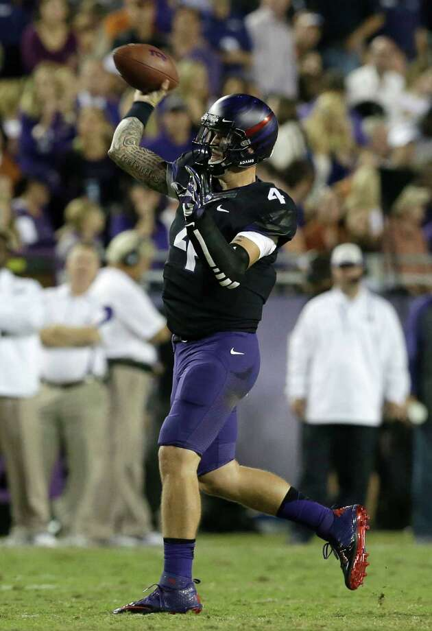TCU quarterback Casey Pachall (4) passes during the first half of an NCAA college football game against Texas, Saturday, Oct. 26, 2013, in Fort Worth, Texas. (AP Photo/LM Otero) Photo: LM Otero, Associated Press / AP