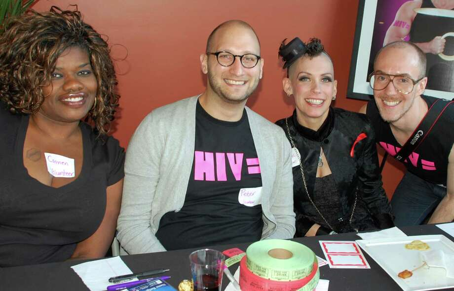 Welcoming attendees to the HIV Equal event Saturday in Norwalk were, from left, Carmen Washington of Meriden, and Peter Senftleben, Miss Holly K and Julien Aledsandres, all from New York City. Photo: Jarret Liotta / Norwalk Citizen contributed