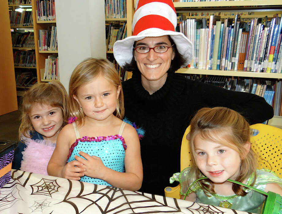 "Selectman Cristin McCarthy Vahey, as the Cat in the Hat, with ""fairies"" Tess Greenberg, 4; Saige Knight, 5, and Delia Hanson, 4, Friday at the Fairfield Public Library's Halloween event. Photo: Mike Lauterborn / Fairfield Citizen contributed"