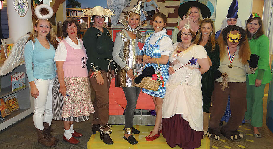 Fairfield Public Library staff in costume -- many of them literary characters -- leading the 2nd annual Halloween Extravaganza for children Friday afternoon. Photo: Mike Lauterborn / Fairfield Citizen contributed