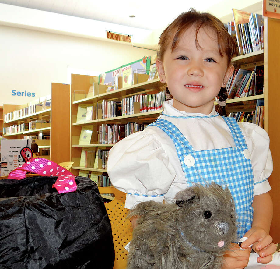 "Sara Melton, 5, of Fairfield, dressed as Dorothy from the "" Wizard of Oz"" at Fairfield Public Library's Halloween party for youngsters Friday. Photo: Mike Lauterborn / Fairfield Citizen contributed"