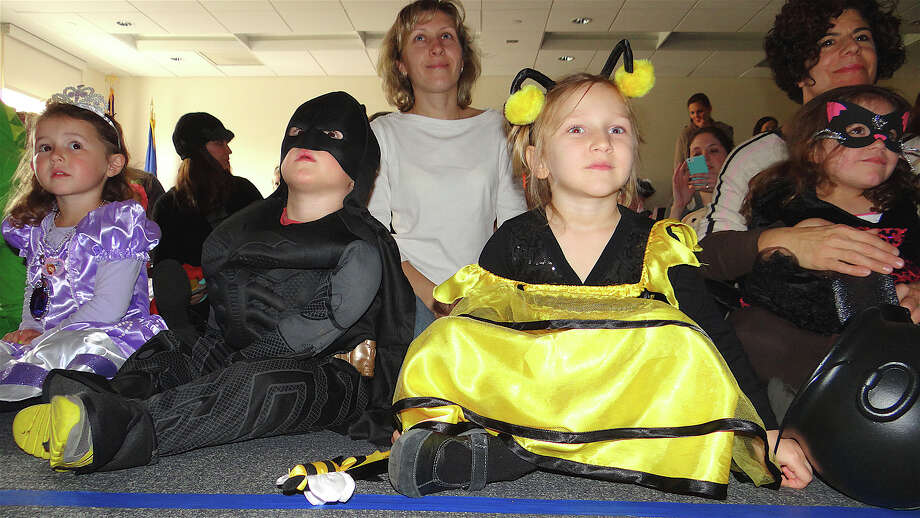 "Costumed kids turned out Friday for the Fairfield Public Library's ""Halloween Extravaganza"" on Friday. Photo: Mike Lauterborn / Fairfield Citizen contributed"