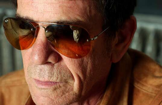 """** ADVANCE FOR WEEKEND EDITIONS, JUNE 5-8 **Singer and songwriter Lou Reed poses for a portrait in New York, April 23, 2003. In early June, Reed, 61, released a new album, """"NYC Man_The Ultimate Lou Reed Collection,"""" a 31-track retrospective that spans his Velvet Underground and solo years. (AP Photo/Gino Domenico) Photo: AP"""