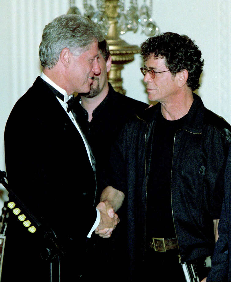 President Bill Clinton meets with rock star Lou Reed follow his performance during the State dinner for Czech President Vaclav Haval September 16, 1998. Photo: Richard Ellis, Getty Images / Hulton Archive