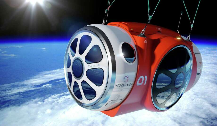 This artist's rendering provided by World View Enterprises on Tuesday, Oct. 22, 2013 shows their design for a capsule lifted by a high-altitude balloon up 19 miles into the air for tourists. Company CEO Jane Poynter said people would pay $75,000 to spend a couple hours looking down at the curve of the Earth. Photo: Uncredited, AP / AP2013