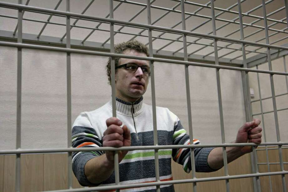 In this photo provided by Greenpeace International, one of their activists Marco Paolo Weber, from Switzerland attends his bail hearing, at a court in Murmansk, Russia, Monday, Oct. 21, 2013.  A previous hearing on Oct. 17 was postponed due to a German speaking interpreter being unavailable at the Regional Court of Murmansk. Weber is one of the 'Arctic 30' who are in custody charged with piracy, punishable for up to 15 years in jail, after being caught on board the Arctic Sunrise, which was seized a month ago by Russian security forces after some activists tried to scale an offshore oil platform. Photo: Igor Podgorny, AP / AP2013