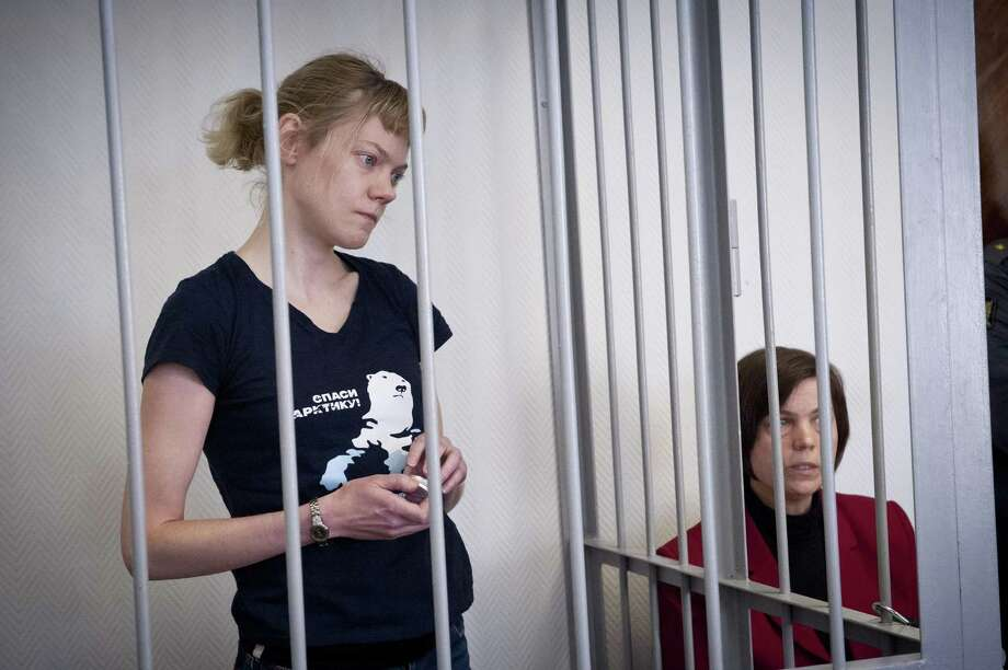 In this photo provided by Greenpeace International, one of their activists Sini Saarela, from Finland, attends her bail hearing, at a court in Murmansk, Russia, Monday, Oct. 21, 2013. Sini Saarela is one of the 'Arctic 30' who are in custody charged with piracy, punishable for up to 15 years in jail, after being caught on board the Arctic Sunrise, which was seized a month ago by Russian security forces after some activists tried to scale an offshore oil platform. Photo: Dmitri Sharomov, AP / AP2013