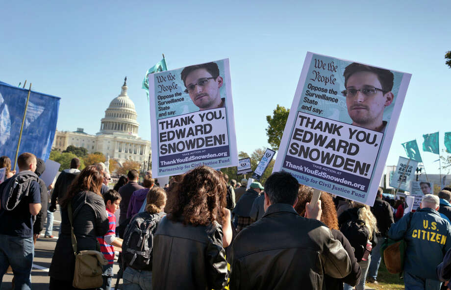 Demonstrators rally at the U.S. Capitol to protest spying on Americans by the National Security Agency, as revealed in leaked information by former NSA contractor Edward Snowden, in Washington, Saturday, October 26, 2013. Photo: J. Scott Applewhite, AP / AP