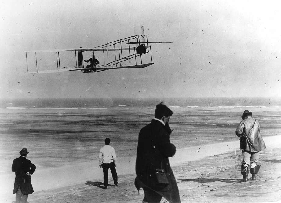 In this undated file photo, Orville and Wilbur Wright test their airplane on a beach. The Wright brothers have long been credited as the first to achieve powered flight. But in June, 2013, Connecticut Gov. Dannel P. Malloy signed a law giving German-born aviator and Connecticut resident Gustave Whitehead the honor of being first. On Thursday, Oct. 23, 1013 Ohio state Rep. Rick Perales and North Carolina state Sen. Bill Cook held news conferences to dispute Connecticut's action and reassert the Wright Brothers were first in flight. Photo: Uncredited, AP / AP2013
