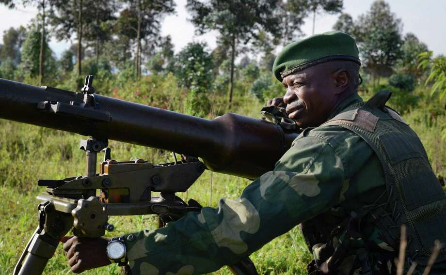 A Congolese army soldier aims artillery towards Kibumba Hill, which is occupied by M23 rebels, around 25kms from the provincial capital Goma, in eastern Congo Sunday, Oct. 27, 2013. The Congolese army says it has taken two more towns in the North Kivu province of eastern Congo in fresh fighting around Kibumba town using tanks and heavy artillery against the M23 rebels. Photo: Joseph Kay, AP / AP