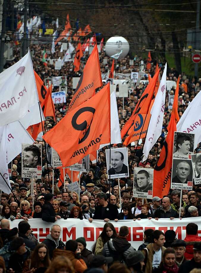 People carry banners and pictures of jailed anti-Putin protesters during an opposition march through the streets of central Moscow. Photo: Vasily Maximov, AFP/Getty Images