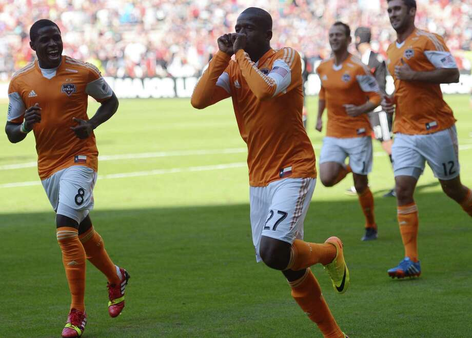 Houston Dynamo midfielder Boniek Garcia (27) celebrates his penalty-kick goal against D.C. United in the first half at RFK Stadium in Washington, D.C., Sunday, October 27, 2013. (Chuck Myers/MCT) Photo: Chuck Myers, McClatchy-Tribune News Service / MCT