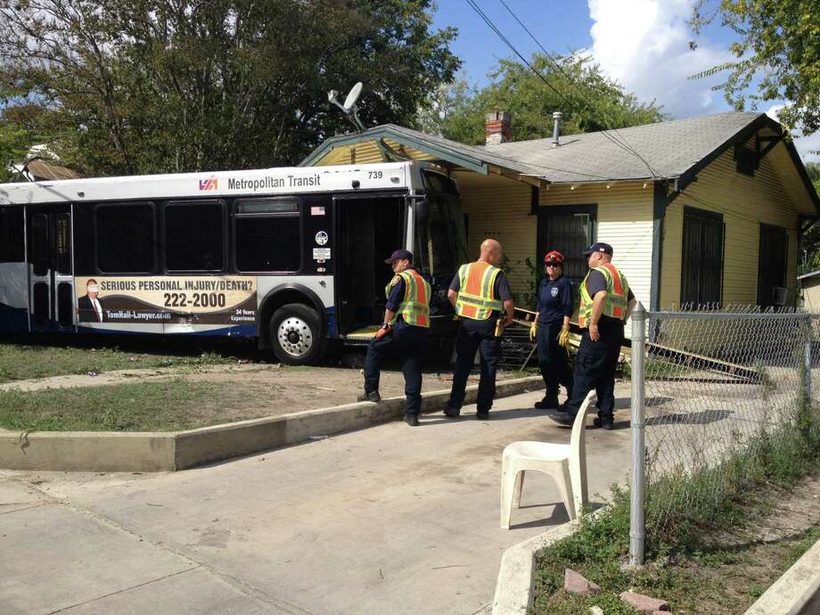 A VIA bus crashed into a home on East Houston Sunday afternoon after swerving to try to avoid hitting a car. No one was injured. Photo: Drew Joseph, San Antonio Express-News / San Antonio Express-News