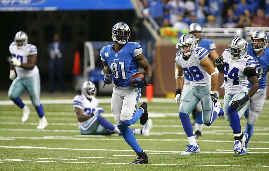 Detroit's Calvin Johnson speeds toward the end zone on an 87-yard reception. The Cowboys were trying to catch up with Johnson all game. Photo: Duane Burleson, Associated Press