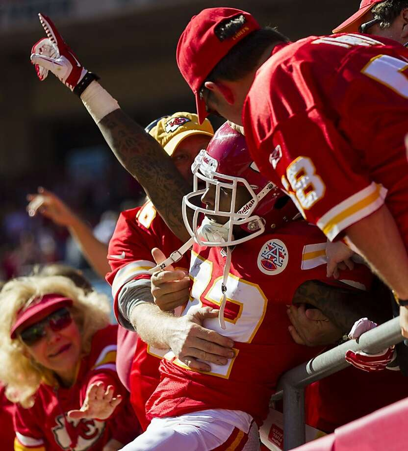 K.C. wide receiver Dexter McCluster celebrates his touchdown with fans. Photo: David Welker, Getty Images