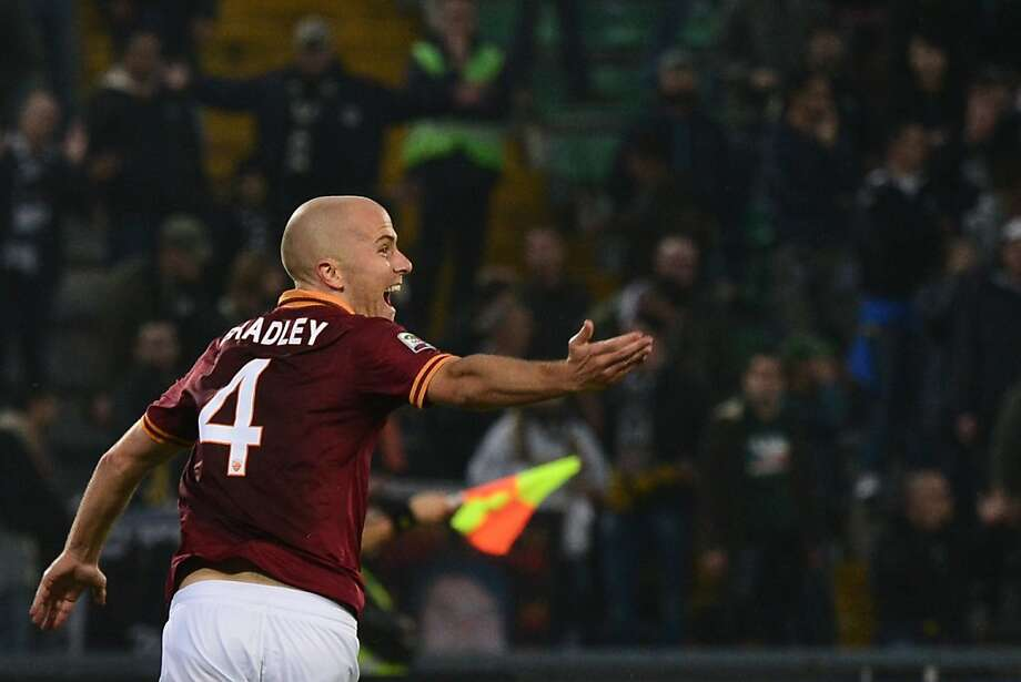 "AS Roma's US midfielder Michael Bradley celebrates after scoring during the Serie A football match Udinese vs AS Roma at ""Stadio Friuli""  in Udine on October 27, 2013. AFP PHOTO / GIUSEPPE CACACEGIUSEPPE CACACE/AFP/Getty Images Photo: Giuseppe Cacace, AFP/Getty Images"