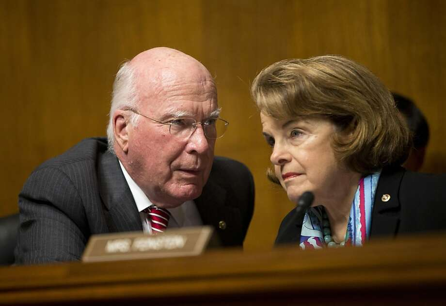 Senate Judiciary Committee Chairman Sen. Patrick Leahy, D-Vt., left, talks with Sen. Dianne Feinstein, D-Calif., on Capitol Hill in Washington, Wednesday, Oct. 2, 2013, during the committee's oversight hearing on the Foreign Intelligence Surveillance Act. U.S. intelligence officials say the government shutdown is seriously damaging the intelligence community's ability to guard against threats. (AP Photo/ Evan Vucci) Photo: Evan Vucci, Associated Press