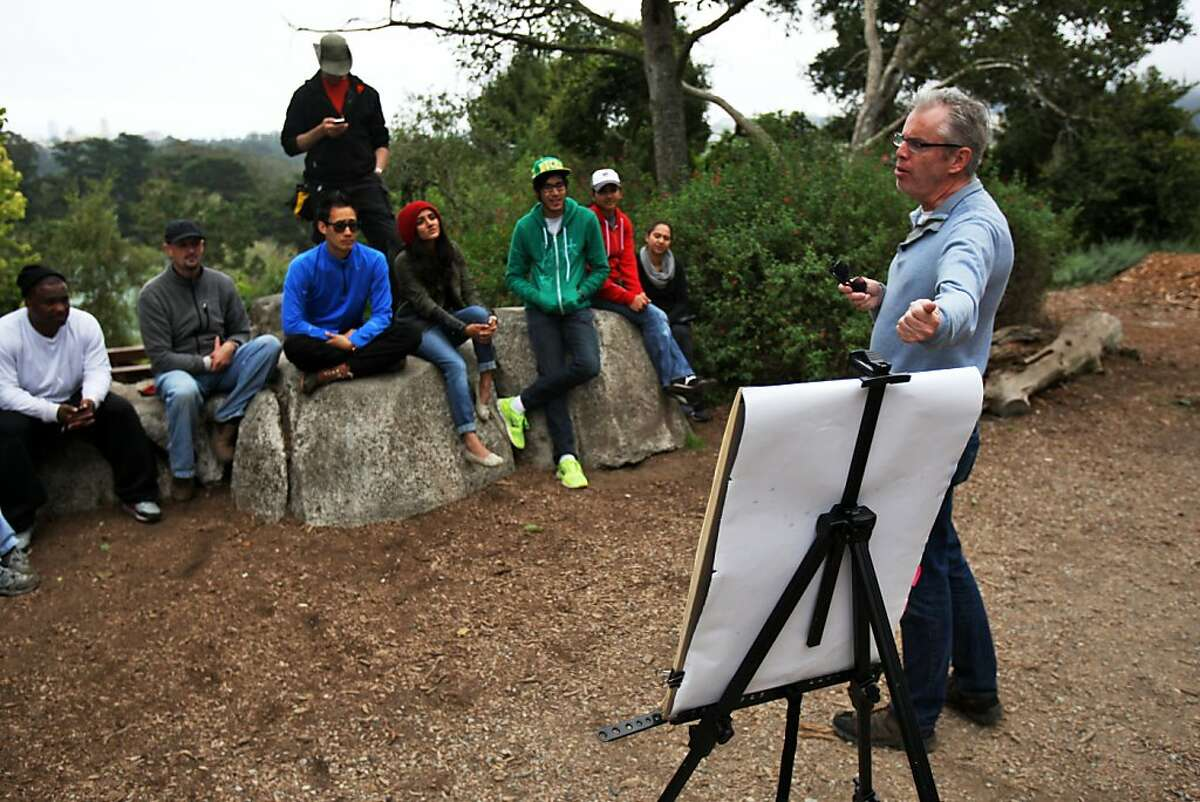 Butterfly expert Liam O'Brien talks to volunteers about butterflies at Strawberry HIll in Golden Gate Park in San Francisco, Calif. on Sunday, Sept 14, 2013.