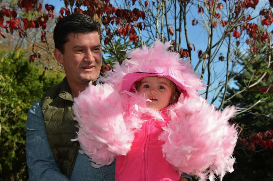 Pink Flamingo Gwyneth Musselman and her dad, Paul Musselman, at the New Canaan Chamber of Commerce's 32nd Annual Halloween Parade on Sunday, Oct. 27, 2013. Photo: Jeanna Petersen Shepard / New Canaan News Freelance