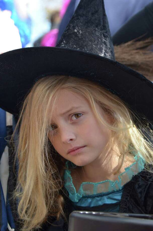 Little witch Ava Cook at the New Canaan Chamber of Commerce's 32nd Annual Halloween Parade on Sunday, Oct. 27, 2013. Photo: Jeanna Petersen Shepard / New Canaan News Freelance