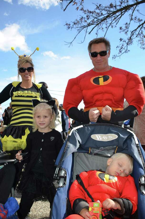 The Cook family, mom Kelly, dad Robert, little sleeping Incredible Christopher, and Dylann, get ready to walk the parade at the New Canaan Chamber of Commerce's 32nd Annual Halloween Parade on Sunday, Oct. 27, 2013. Photo: Jeanna Petersen Shepard / New Canaan News Freelance