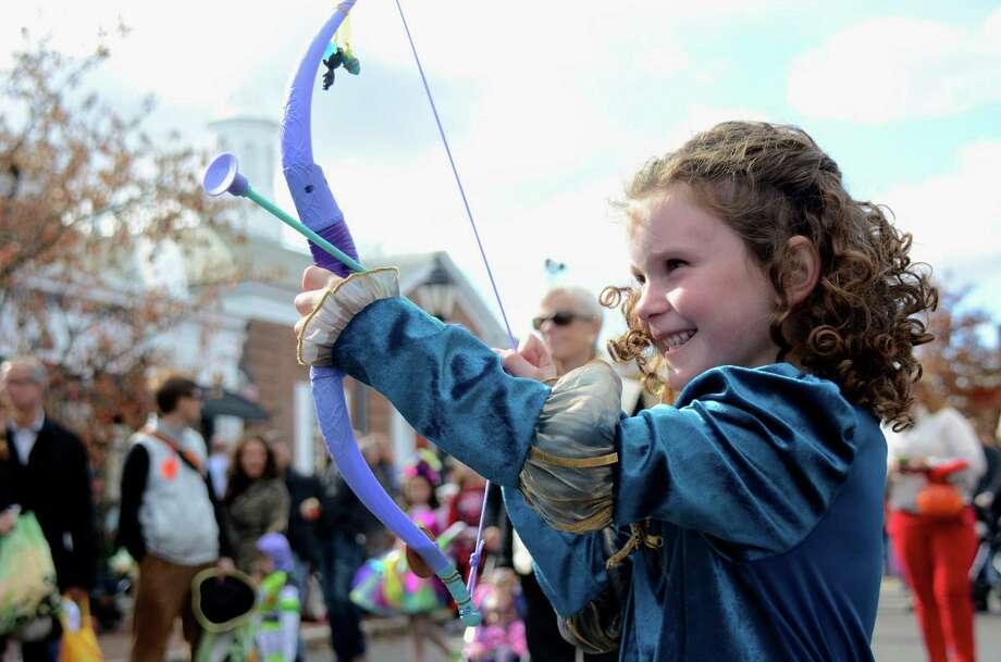 "Cate Goldman, as Marida from ""The Brave,"" takes aim, at the New Canaan Chamber of Commerce's 32nd Annual Halloween Parade on Sunday, Oct. 27, 2013. Photo: Jeanna Petersen Shepard / New Canaan News Freelance"