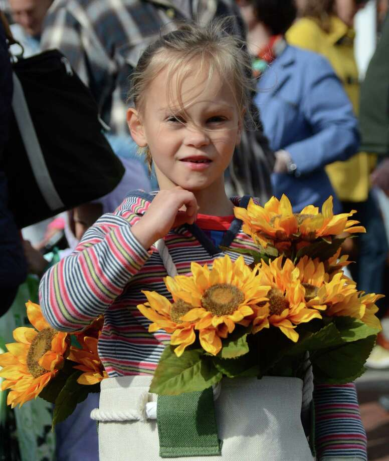 Six-year-old Graysen Strine is her own basket of flowers at the New Canaan Chamber of Commerce's 32nd Annual Halloween Parade on Sunday, Oct. 27, 2013. Photo: Jeanna Petersen Shepard / New Canaan News Freelance