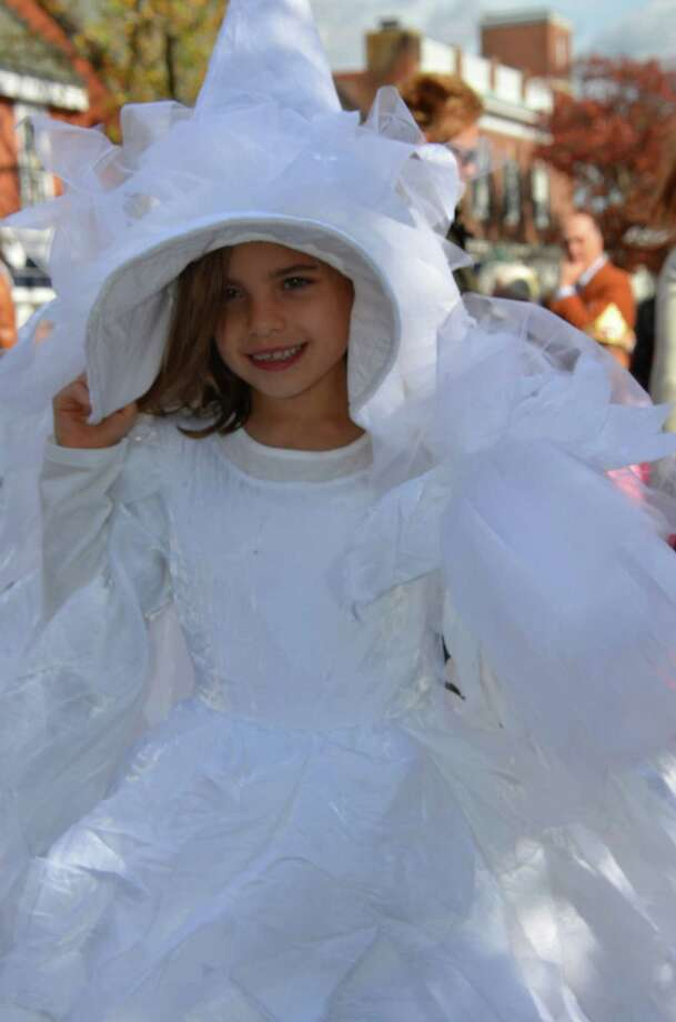 Seven-year-old white witch Alexandra LaSousa shares her birthday with the New Canaan Chamber of Commerce's 32nd Annual Halloween Parade on Sunday, Oct. 27, 2013. Photo: Jeanna Petersen Shepard / New Canaan News Freelance