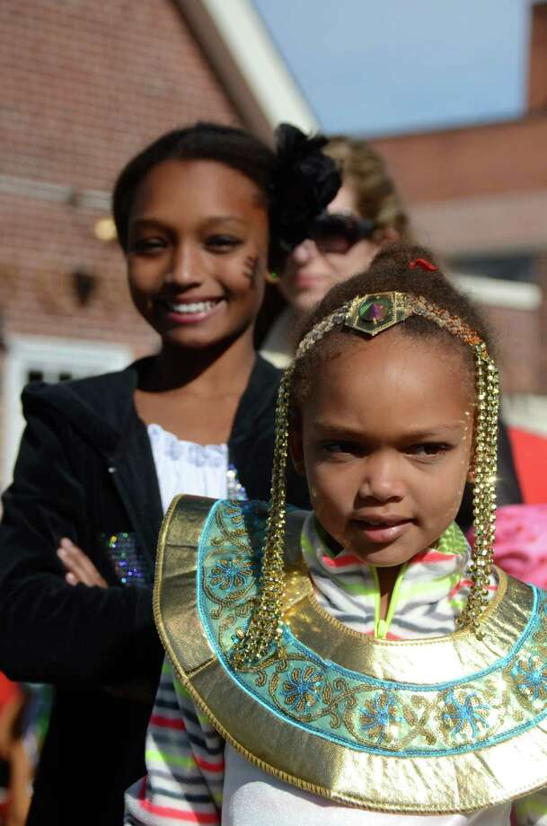 Chloe Oyekanmi, a goddess for the day, with her sister Maiah, at the New Canaan Chamber of Commerce's 32nd Annual Halloween Parade on Sunday, Oct. 27, 2013. Photo: Jeanna Petersen Shepard / New Canaan News Freelance