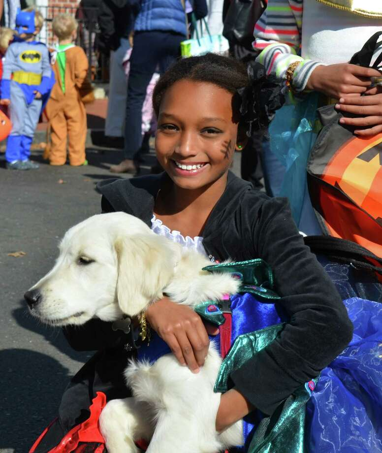 Maiah Oyekanmi with her dog, Sky, at the New Canaan Chamber of Commerce's 32nd Annual Halloween Parade on Sunday, Oct. 27, 2013. Photo: Jeanna Petersen Shepard / New Canaan News Freelance