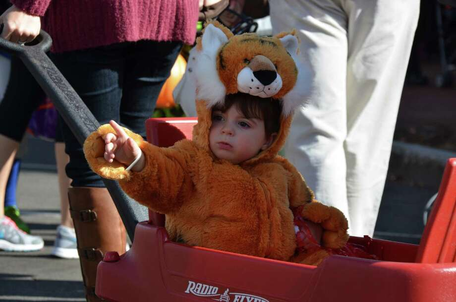 Henry O'Keeffe gets a ride at the New Canaan Chamber of Commerce's 32nd Annual Halloween Parade on Sunday, Oct. 27, 2013. Photo: Jeanna Petersen Shepard / New Canaan News Freelance
