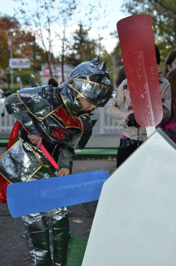 Sir Connor McIntosh plays a little mini golf at the New Canaan Chamber of Commerce's 32nd Annual Halloween Parade on Sunday, Oct. 27, 2013. Photo: Jeanna Petersen Shepard / New Canaan News Freelance