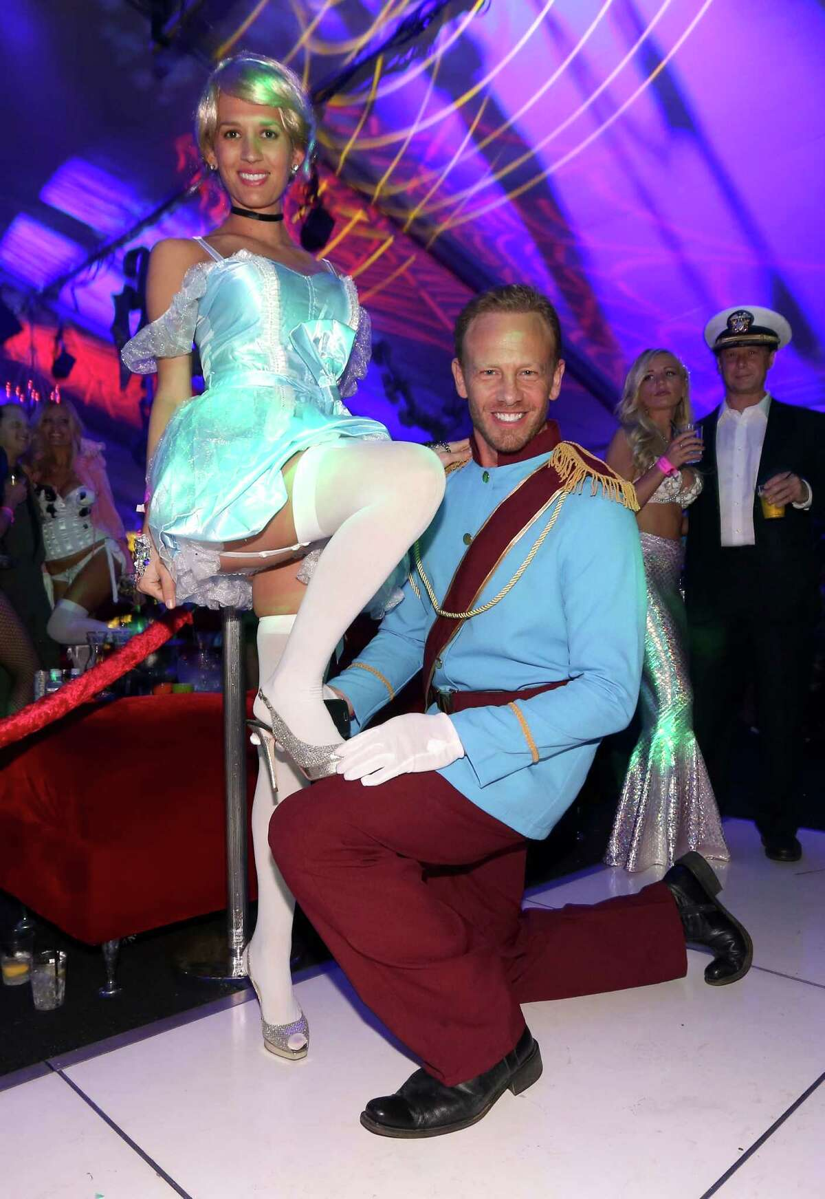 Actor Ian Ziering (R) and Erin Kristine Ludwig attend Playboy Mansion's annual Halloween bash on October 26, 2013 in Holmby Hills, California.