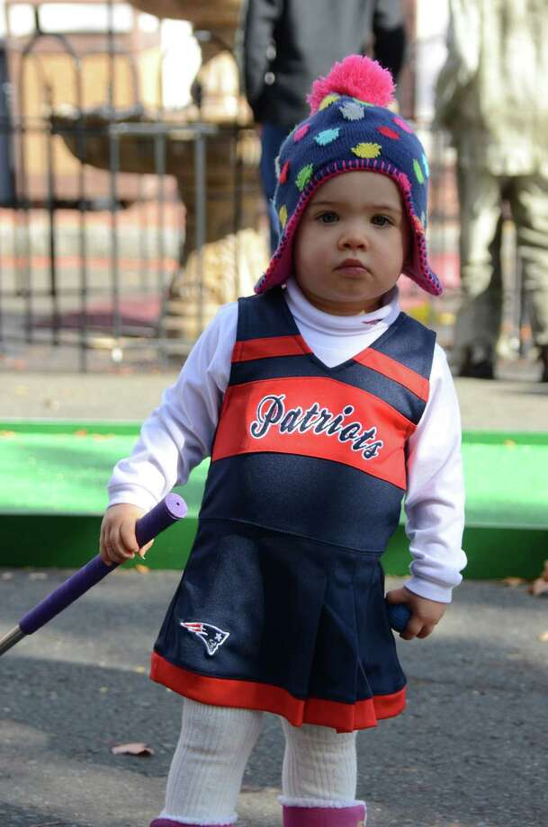 A Patriots fan - 18-month-old Liliana Favale - was sighted at the New Canaan Chamber of Commerce's 32nd Annual Halloween Parade playing mini golf, on Sunday, Oct. 27, 2013. Photo: Jeanna Petersen Shepard / New Canaan News Freelance