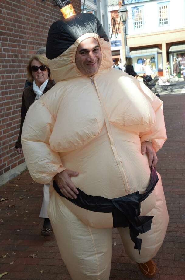 Sumo wrestler Andrew Kurian gets lots of laughs at the New Canaan Chamber of Commerce's 32nd Annual Halloween Parade on Sunday, Oct. 27, 2013. Photo: Jeanna Petersen Shepard / New Canaan News Freelance