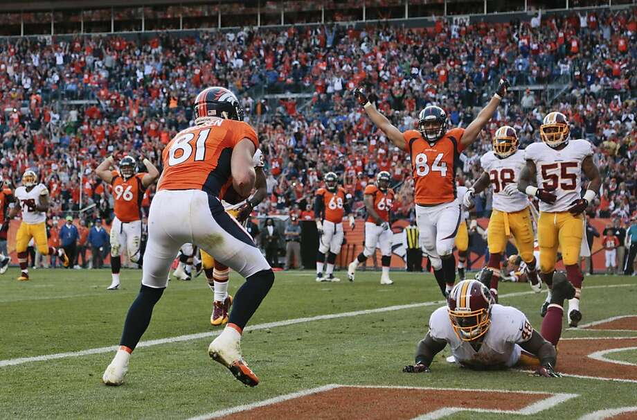 Tight end Joel Dreessen (81) scores on one of four touchdown passes for Denver. Photo: Joe Mahoney, Associated Press
