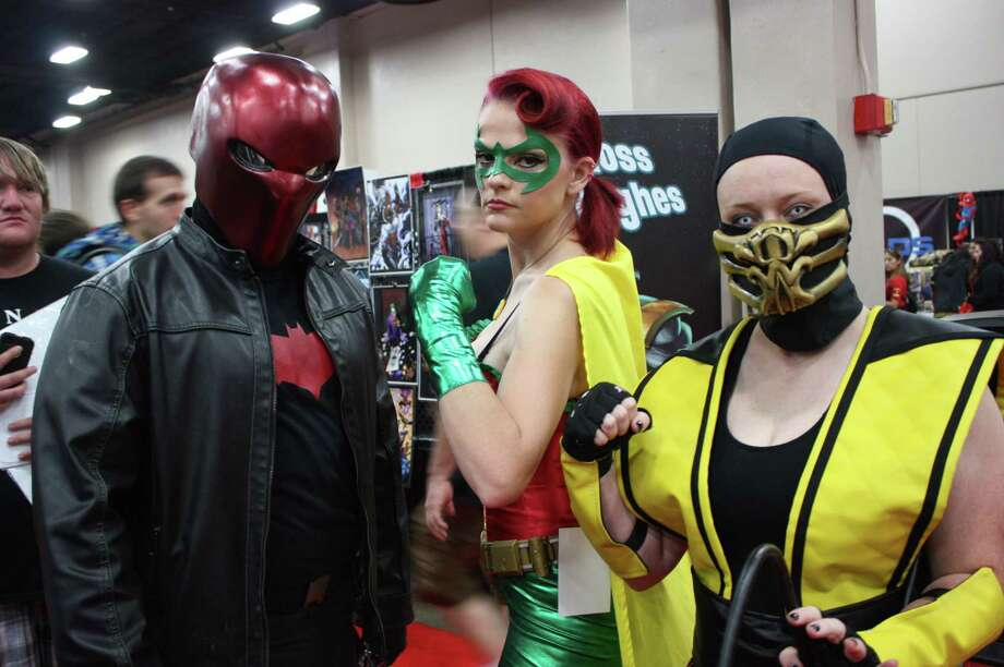 Conventioneers geek out during the final day of the 2013 Alamo City Comic Con. Photo: Photos By Libby Castillo, For MySA.com