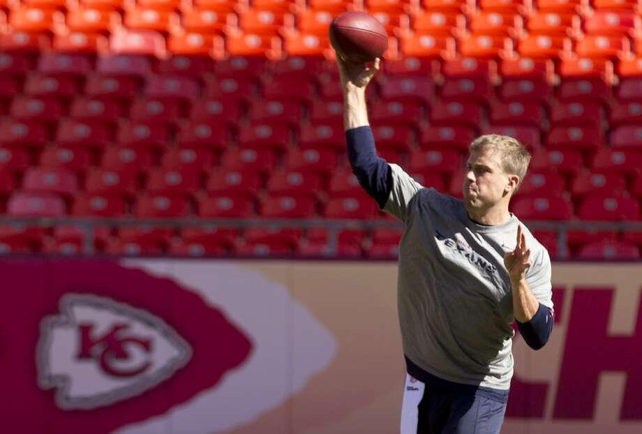 Case Keenum throws a pass during warmups. Photo: Brett Coomer, Houston Chronicle