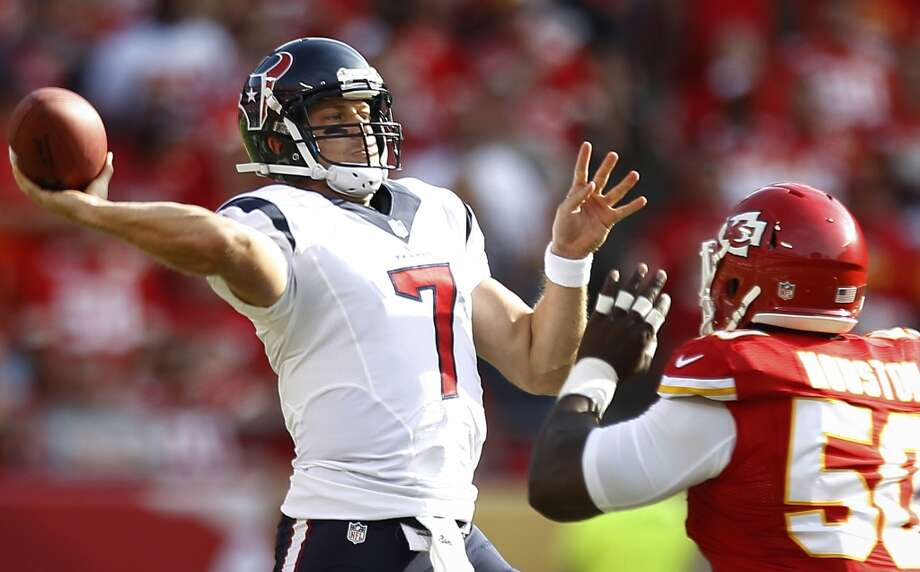 Case Keenum releases a pass as he is pressured by Kansas City Chiefs outside linebacker Justin Houston during the first quarter. Photo: Brett Coomer, Houston Chronicle