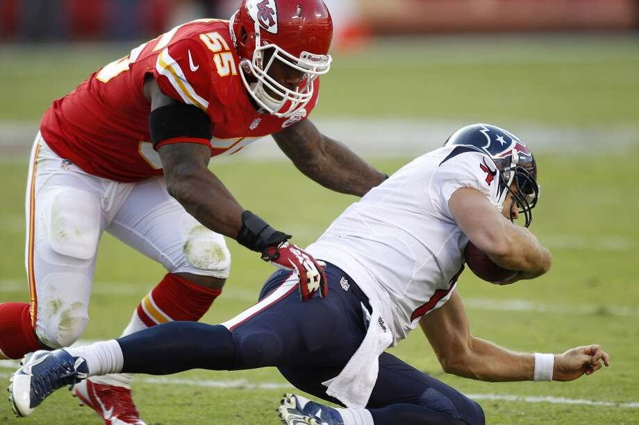 Chiefs inside linebacker Akeem Jordan (55) tackles Houston Texans quarterback Case Keenum after Keenum was forced out of the pocket during the third quarter. Photo: Brett Coomer, Houston Chronicle